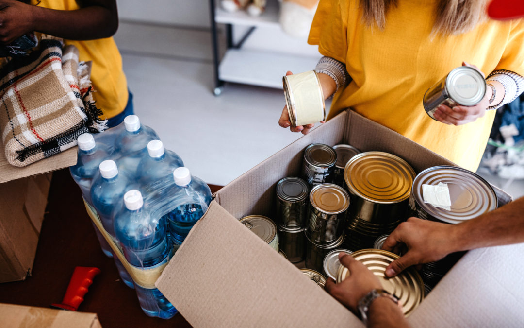 Group of residents collect food and water donations to help their community.